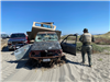 Deputy stands near abandoned vehicle