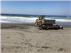 Front loader on the beach