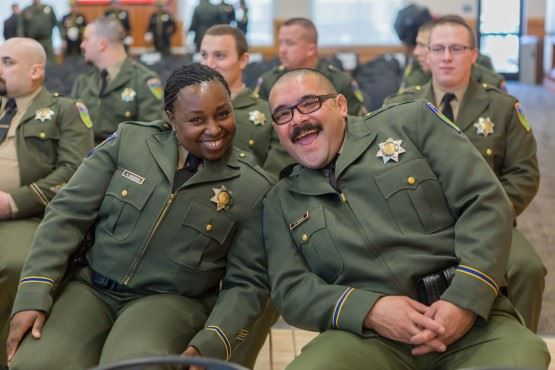 Deputies Sherrod and Masaki smiling for the camera