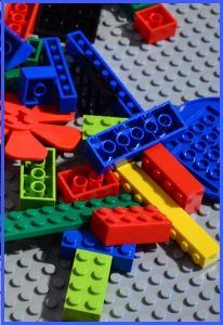 A pile of plastic Lego building blocks, ready for construction.