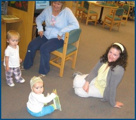 Two very young children and their mothers in the Eureka Library Childrens Room