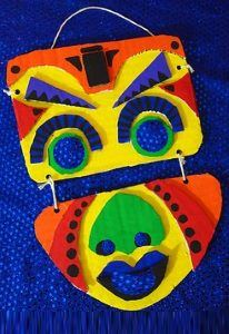 A colorful layered-paper mask tied with string.
