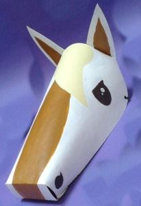 A paper mask of a horse's long face and pointed ears.