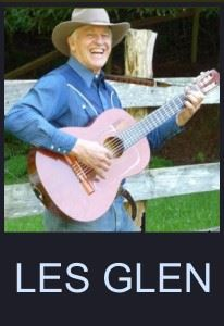 Les Glen's cowboy-hatted face crinkles in a smile as he plays his acoustic guitar by a split-rail