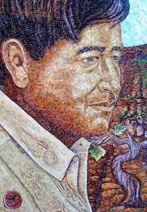 Cesar Chavez mosaic portrait shows a stocky, serious Chicano man.