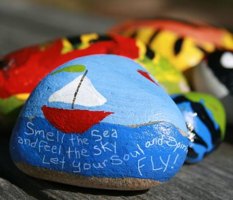 A sailboat painted rock, smell the see and feel the sky.