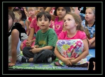 Wide-eyed children listen at story time.