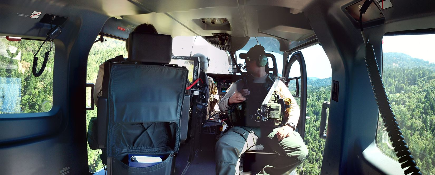 Photo of Sheriff Honsal and an EMT flying in a helicopter over Humboldt County