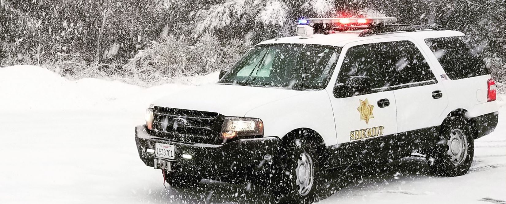 Patrol car in the snow at Berry Summit