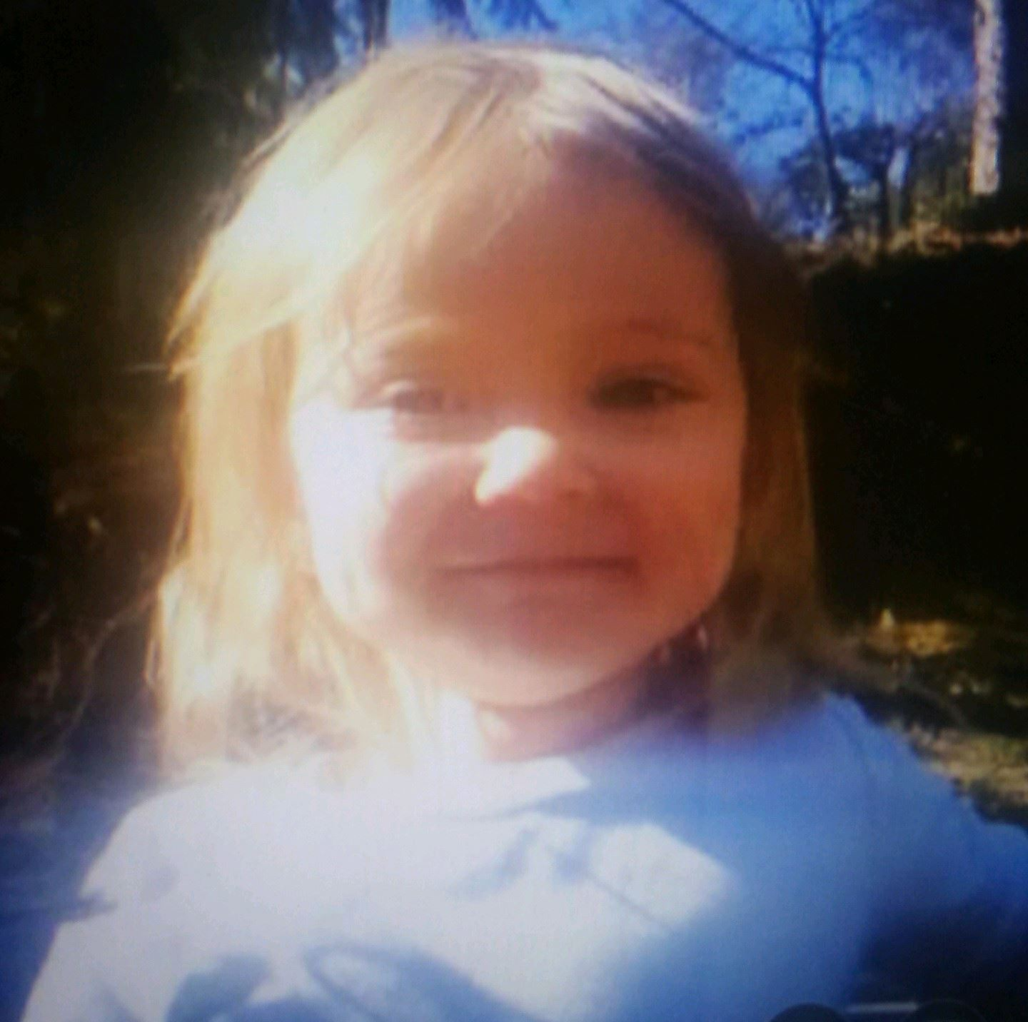 Mira Carter is described as a Caucasian female toddler, with blonde hair and blue eyes. She is 2 fee