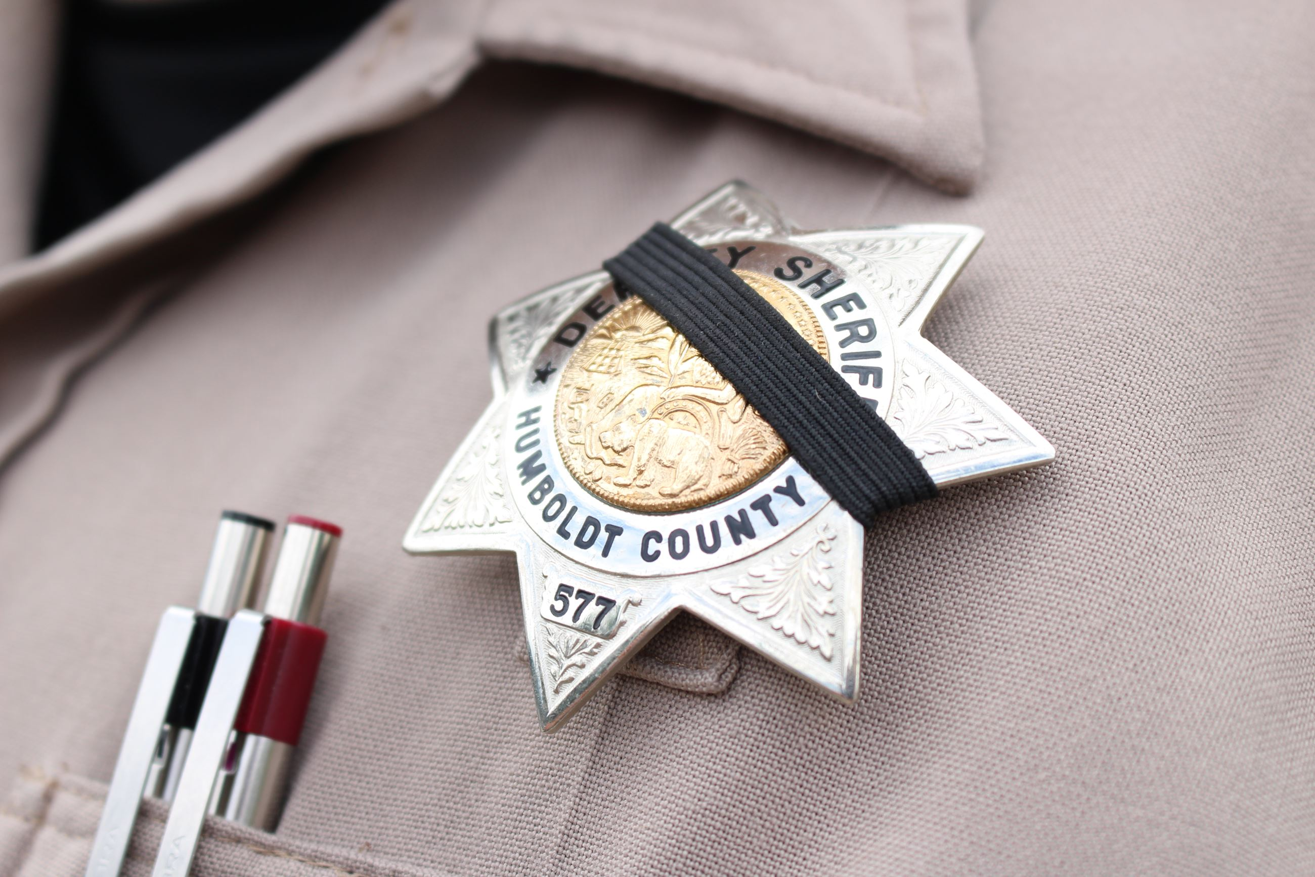 A black mourning band is placed on a sheriff&#39s badge