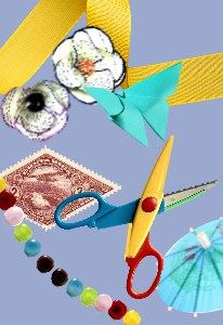 Scissors, folded paper, a stamp, beads, ribbon, craft materials.