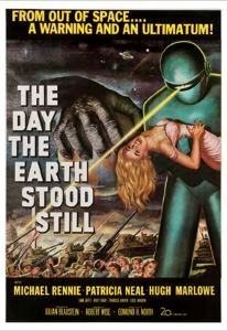 A green suited hominid clasps a pink clad blonde on the film poster.