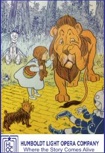 The Cowardly Lion, Dorothy, Toto & friends in an old illustration.