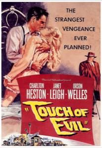 Charlton Heston clasps a negligee-clad Janet Leigh in his arms on the poster.