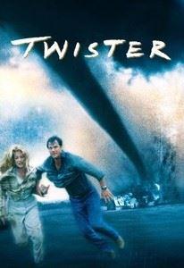 A huge tornado slices through a distant house as a couple runs in panic.