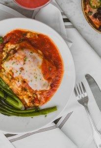 Succulent chicken is smothered in a rich Italian tomato sauce.