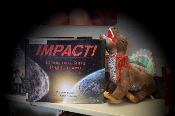 Dino T. Rex picked 'Impact' - a book about asteroids.