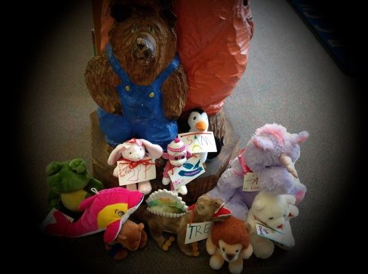 The stuffed animals met Baby Bear, who is happy to meet new friends.