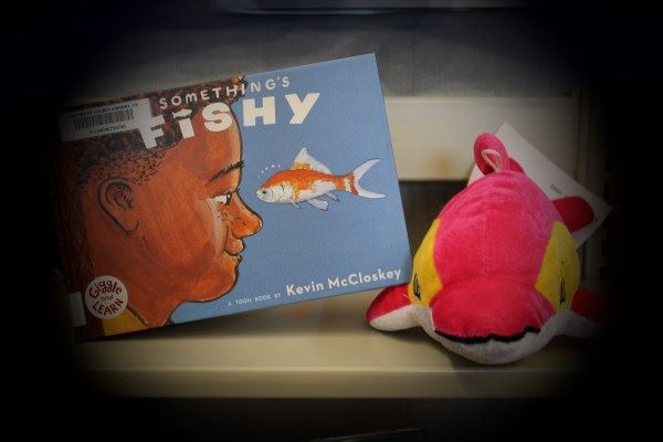Dolphin picked the book 'Something's Fishy'