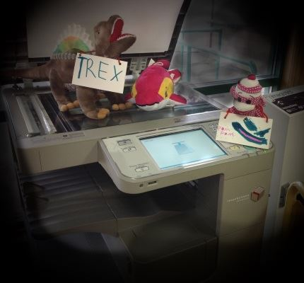 The dinosaur and the dolphin use the copy machine to copy - themselves.