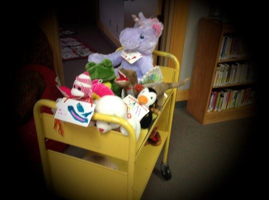 All stuffies board the double-decker trolley for a library tour.