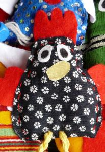 This speckled chicken is one example of a hand-made puppet.