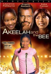 Akeelah shines as she steps up to the microphone in her pink T-shirt.