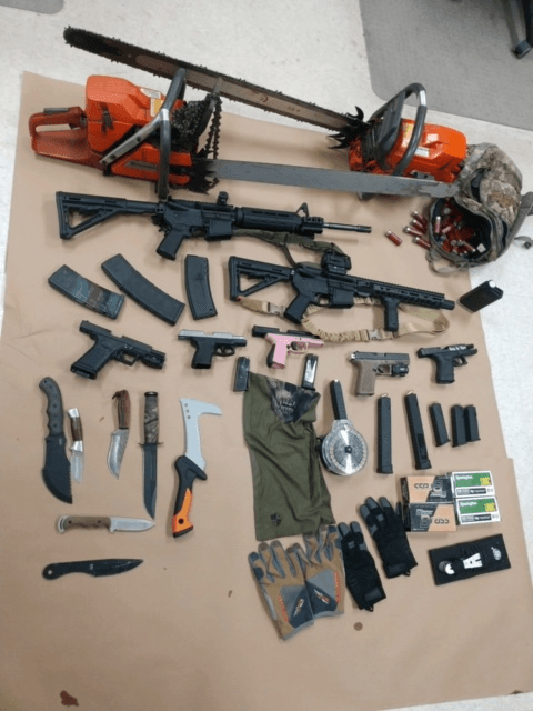 Illegal guns, ammunition, stolen chainsaws and other items found during a search warrant