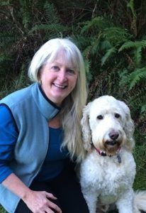 Jean Ann with Rufus the big white dog, who loves to make new friends.