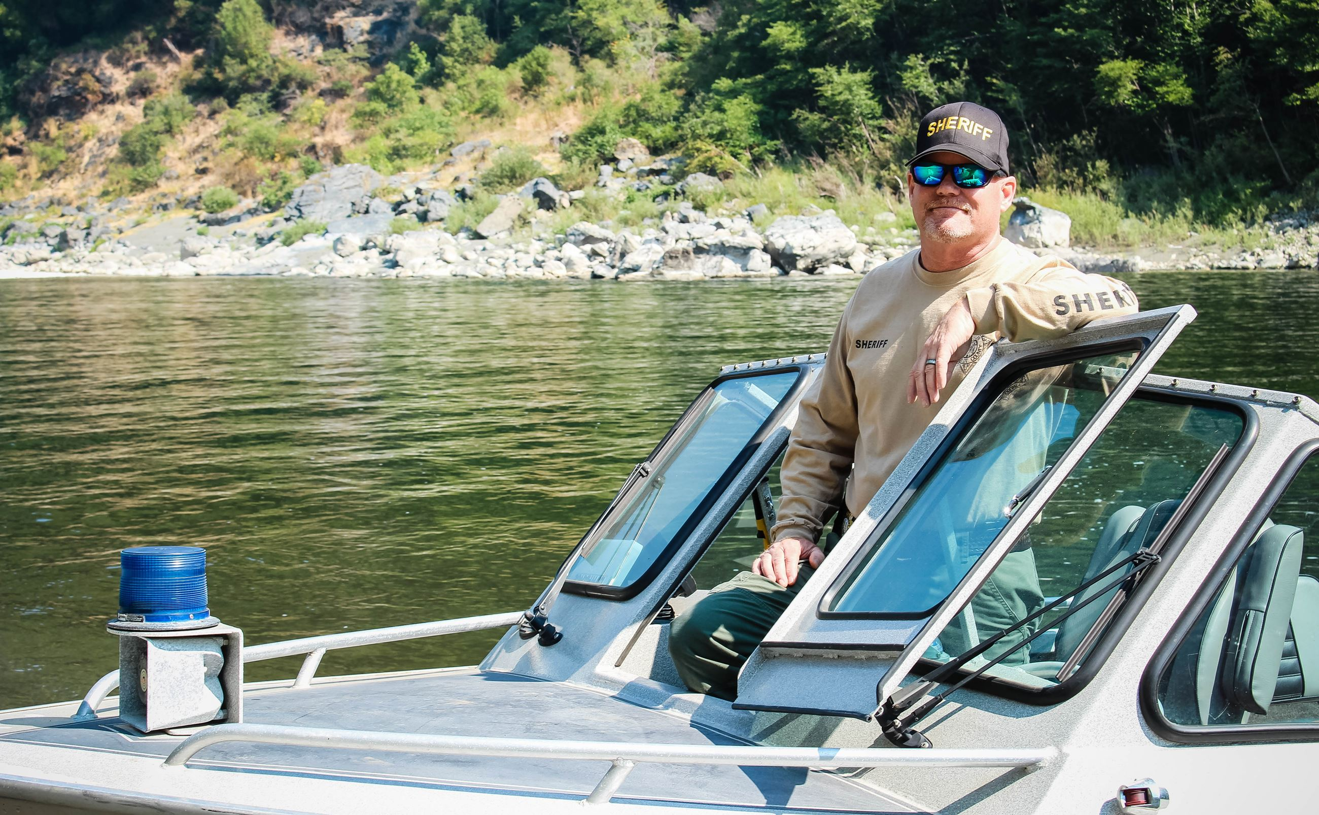 Sheriff's Lt. Mike Fridley stands on the Sheriff's Jet boat