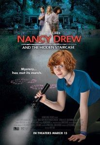 This redheaded Nancy uses her flashlight to navigate a dark, hidden passage.