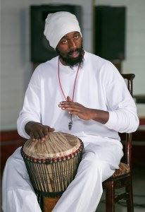 Here's Pierre Tchetgen playing an African drum.