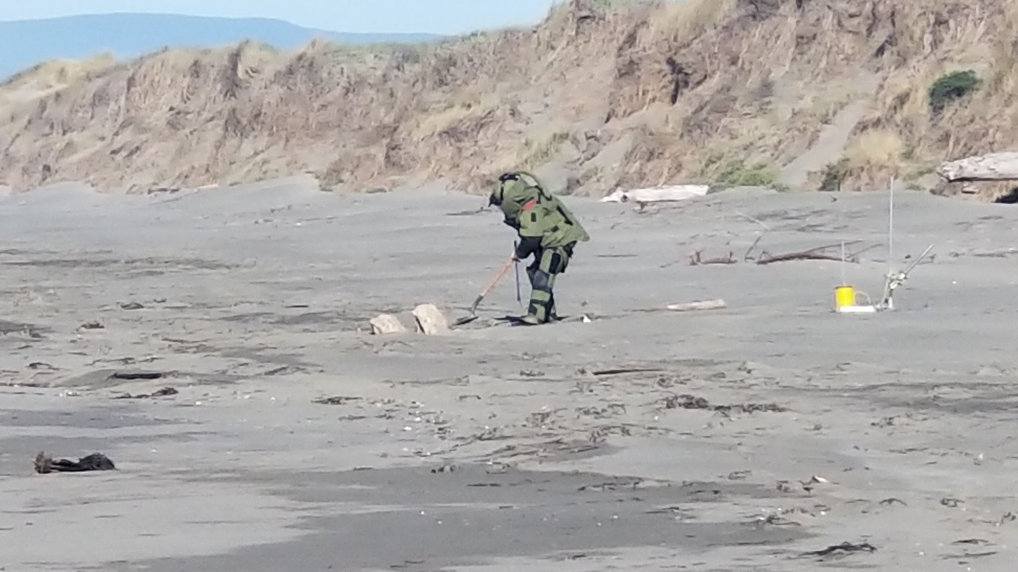 Deputy in a bomb suit renders a live device safe