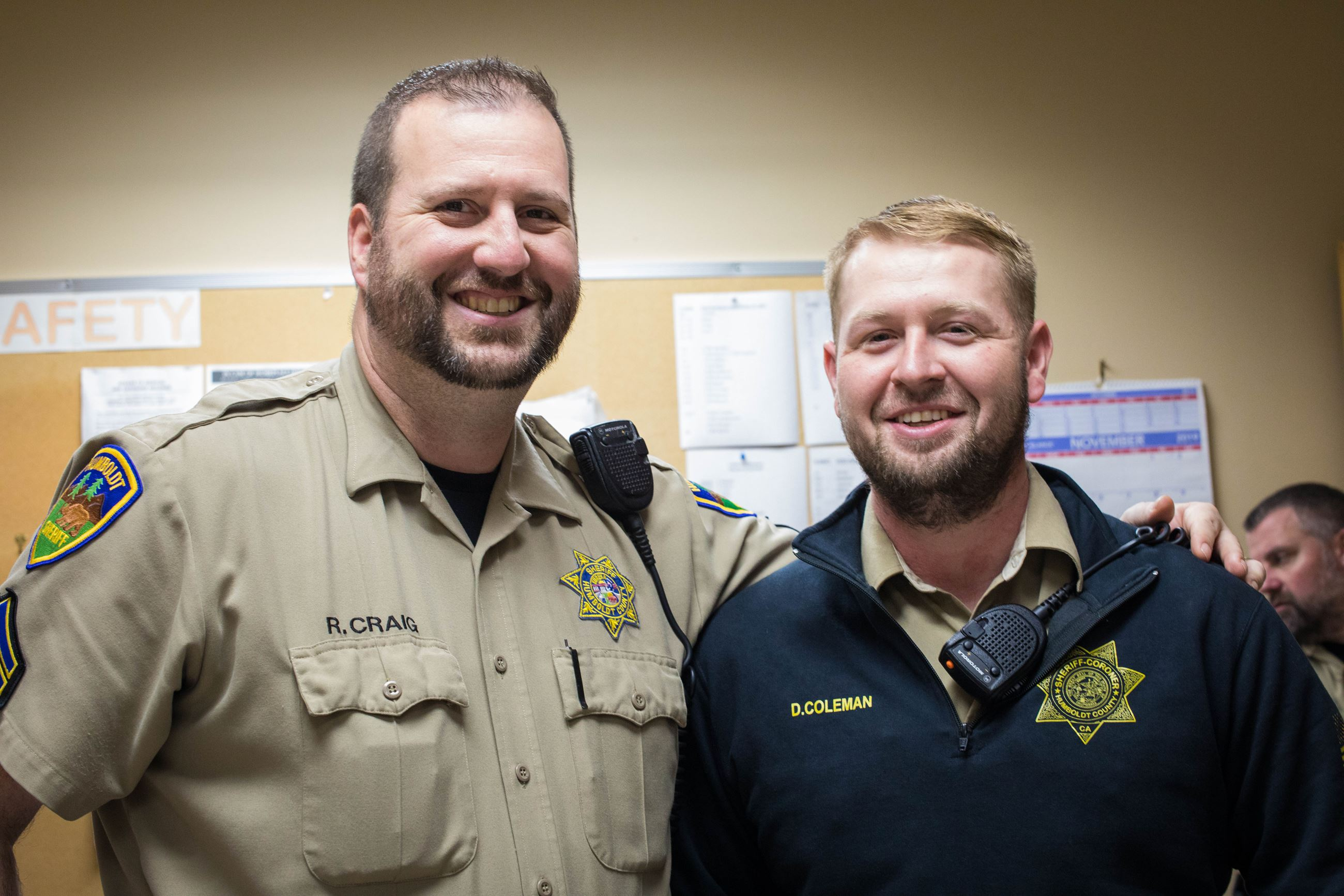 Two correctional deputies smile