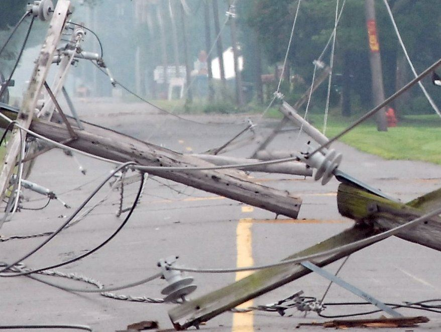 downed-wires-downed-telephone-pole-in-road