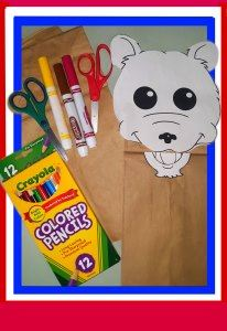 It's easy & fun to make a paper bag puppet, whose mouth opens at the bag crease.