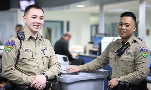 Two correctional deputies in the jail processing area