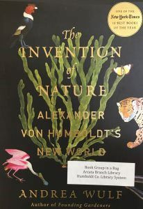 The Invention of Nature by Andrea Wulf, with plants and colorful creatures on the cover.