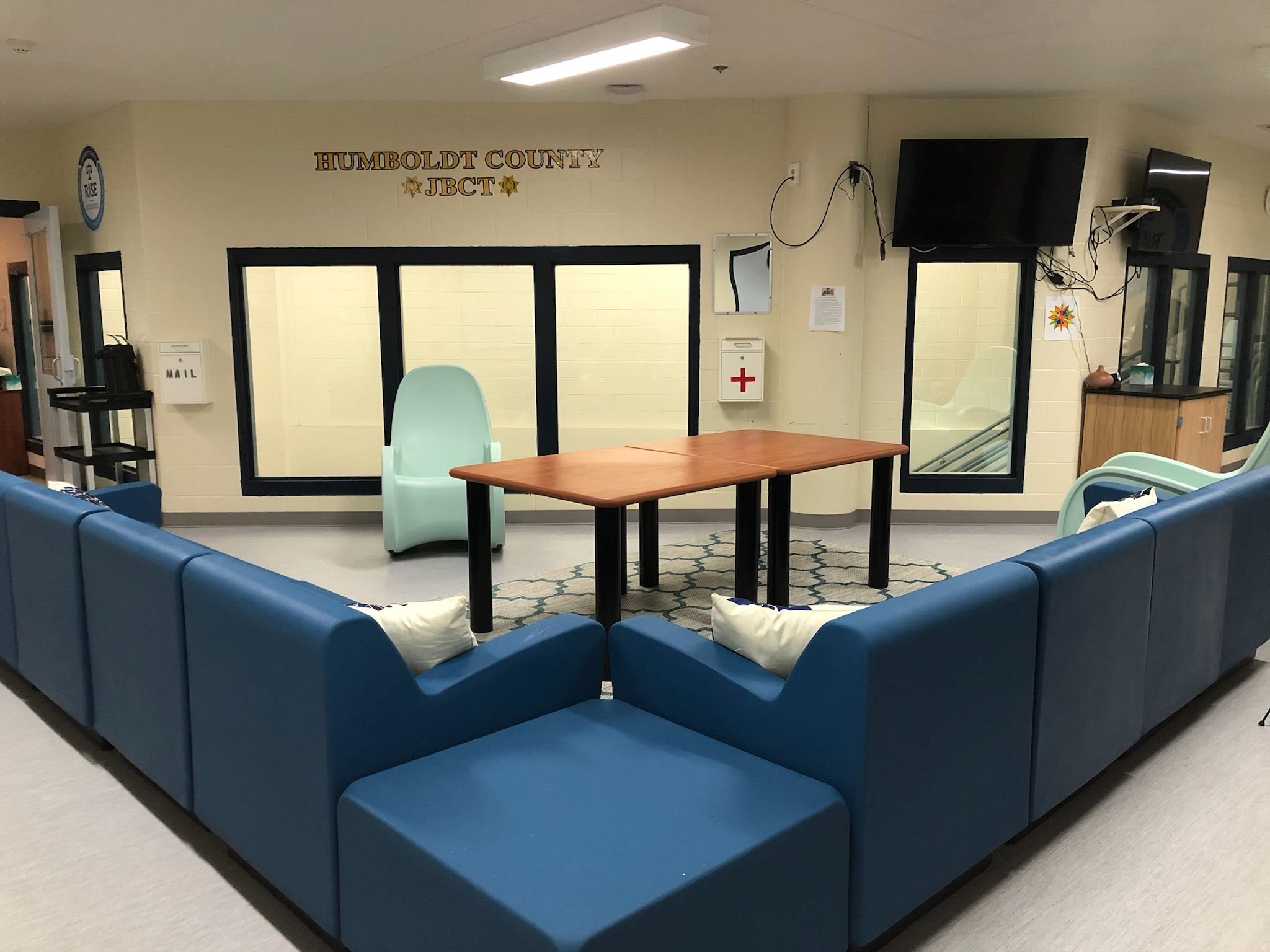 A L-Shaped couch and a rocking chair in the new JBCT unit of the jail