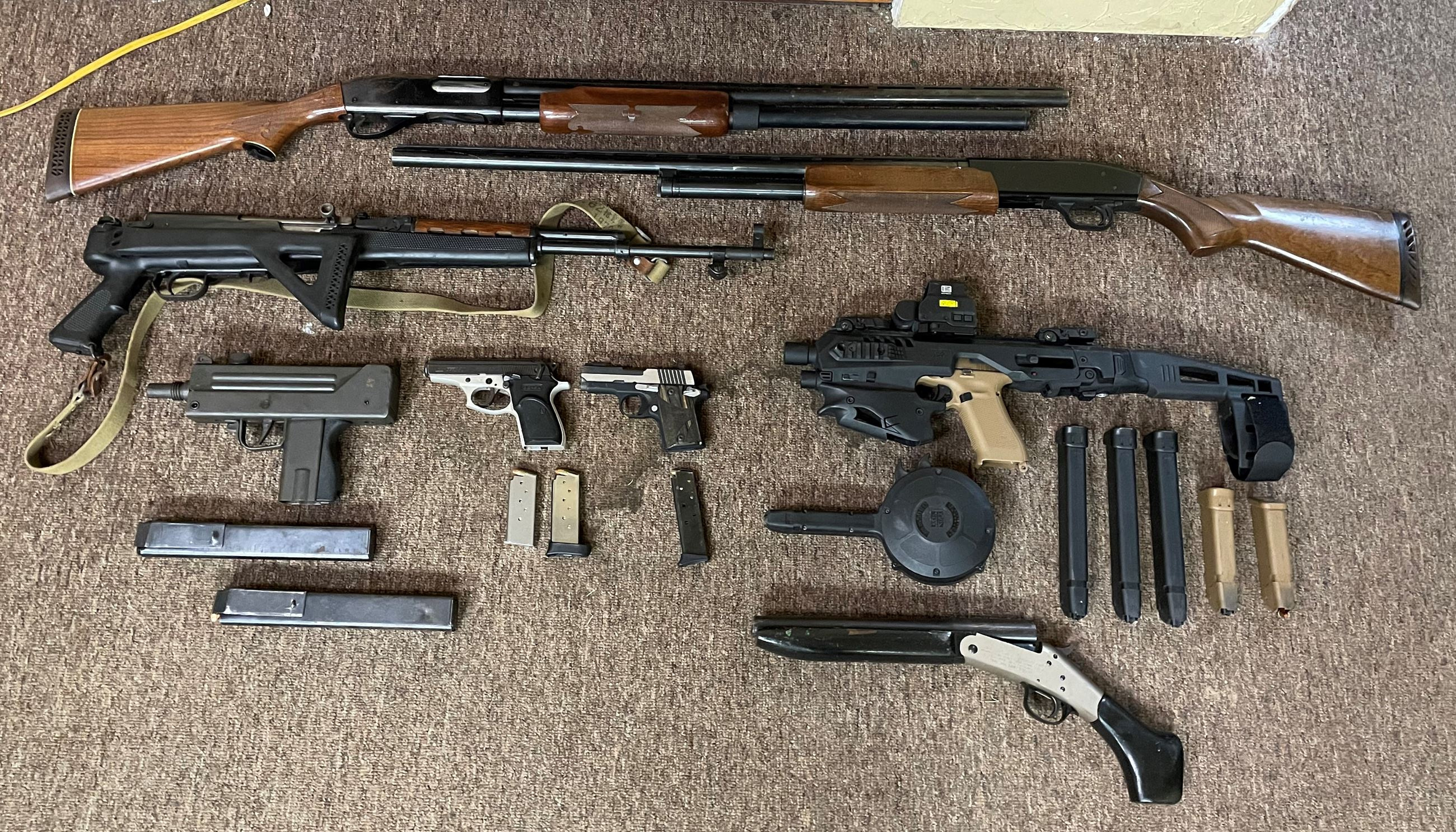 Eight illegal firearms and high capacity magazines