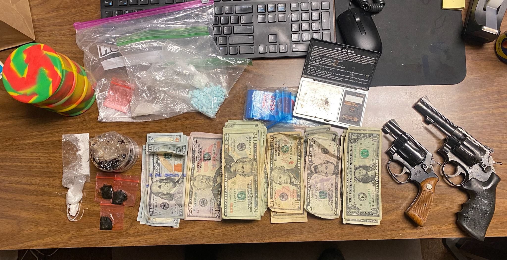 Drugs, cash, guns seized during traffic stop
