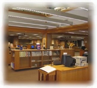 Eureka Main Library Interior showing woodwork, natural light, books, computers, and more.