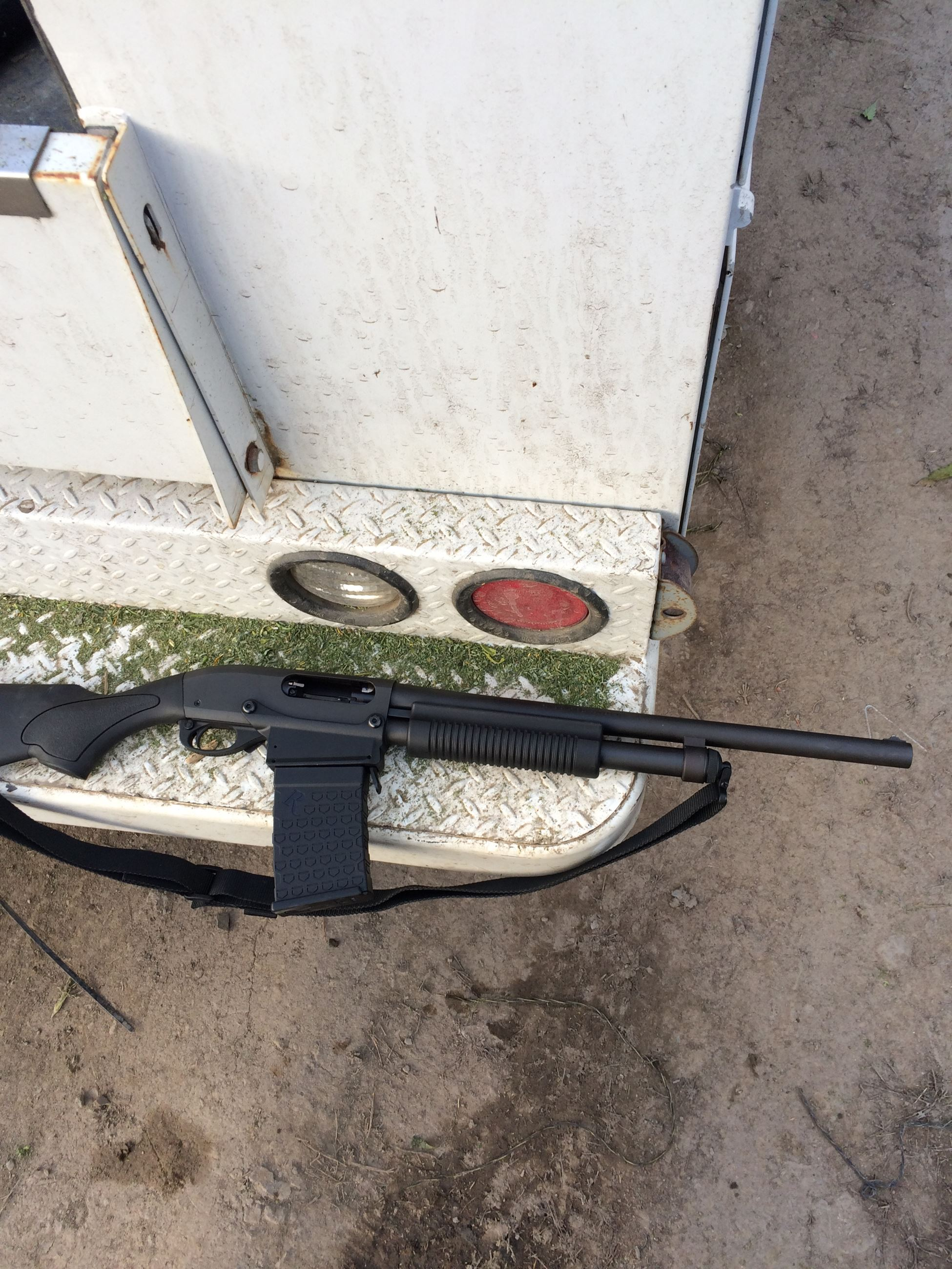 Firearm and magazine seized during search warrant.