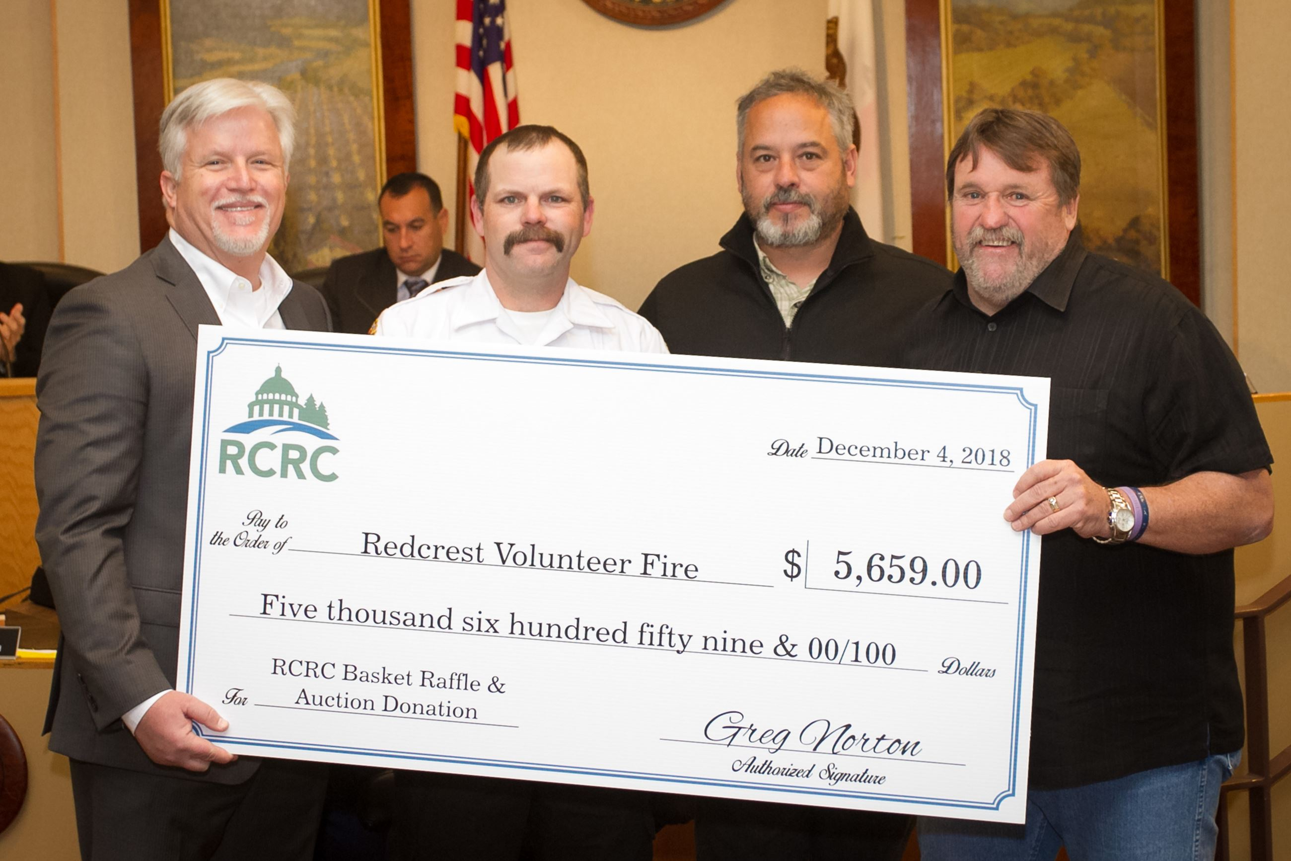 Supervisor Rex Bohn, right, and RCRC Chief Executive Officer Greg Norton, left, present the Redcrest