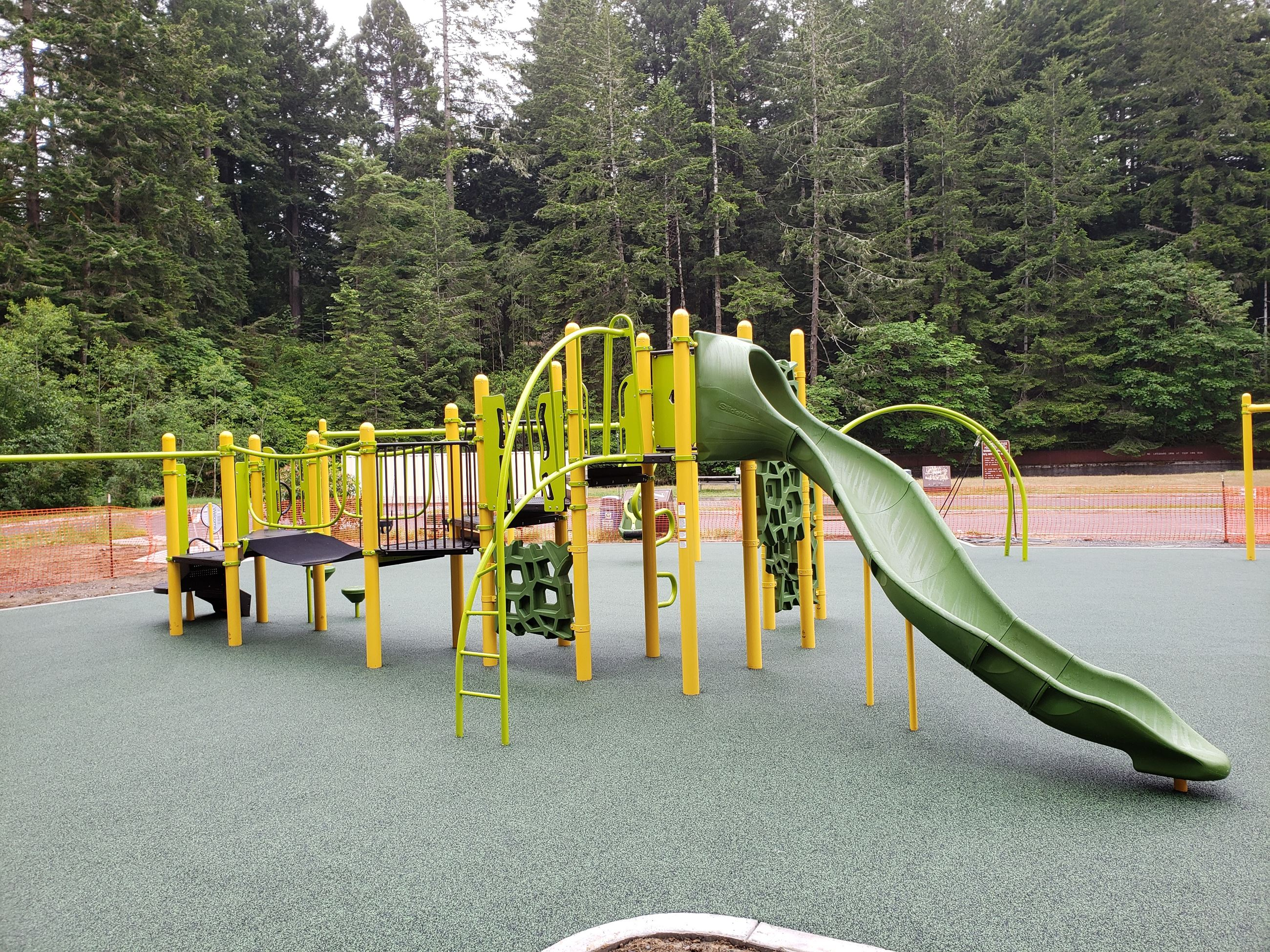 Freshwater Park's ADA-accessible park is shown with slide and climbing feature.