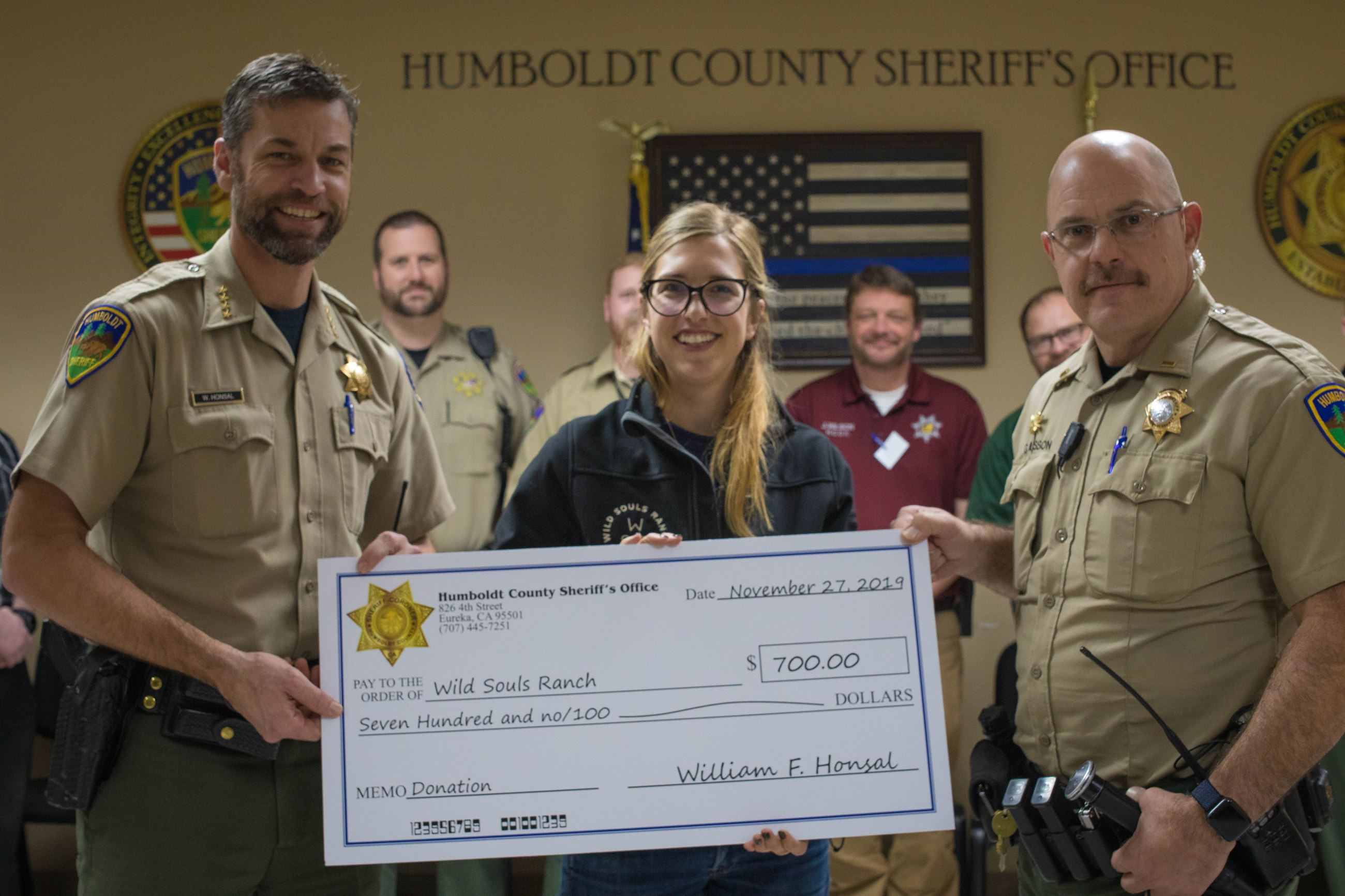Sheriff Honsal and Lt. Musson present a check to a Wild Souls Ranch representative