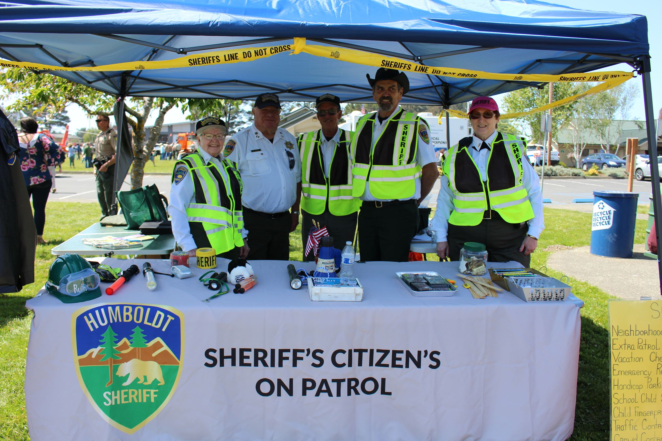 A group of SCOP Volunteers standing behind a table