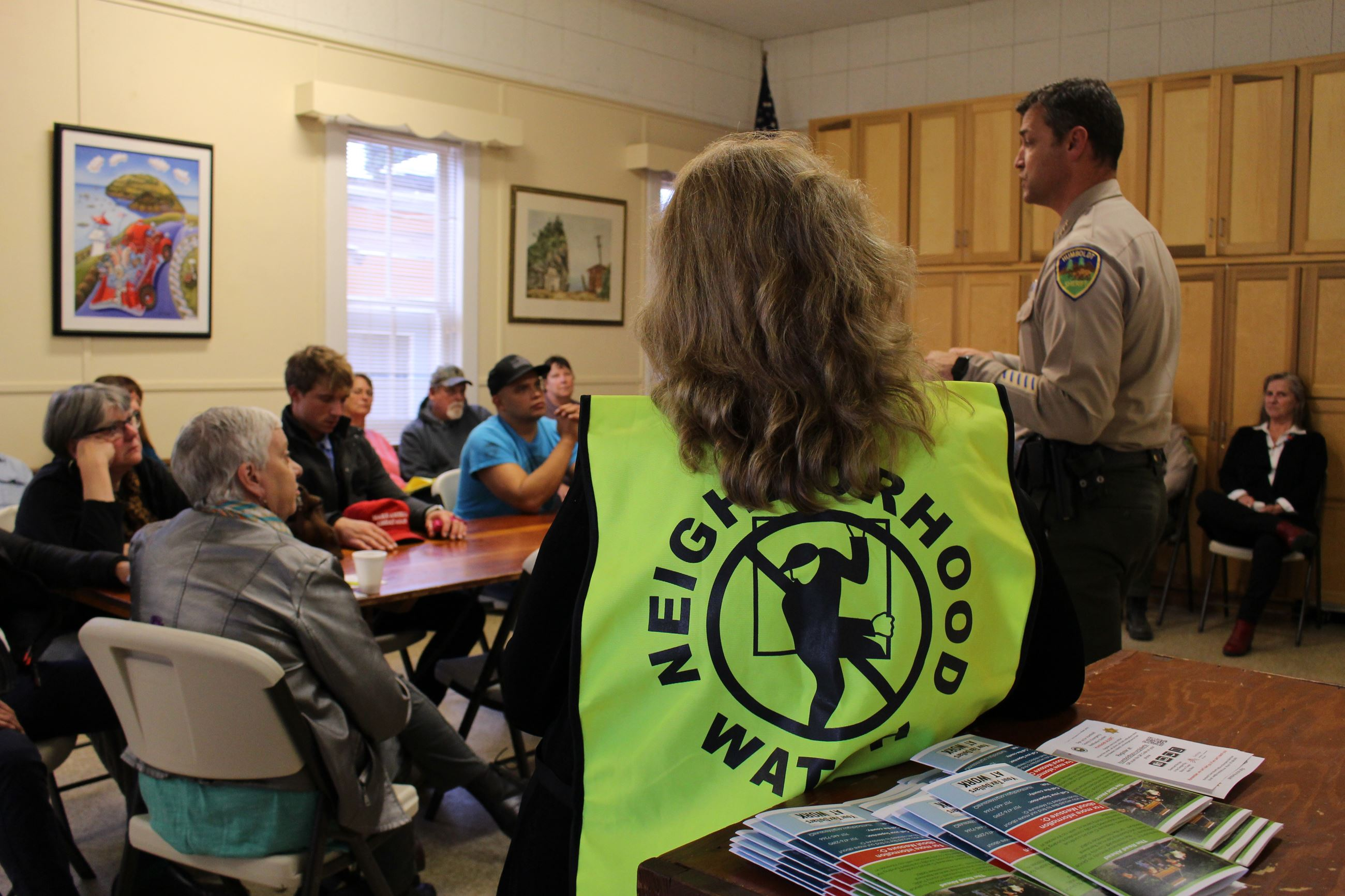 A Neighborhood Watch volunteer with a vest on