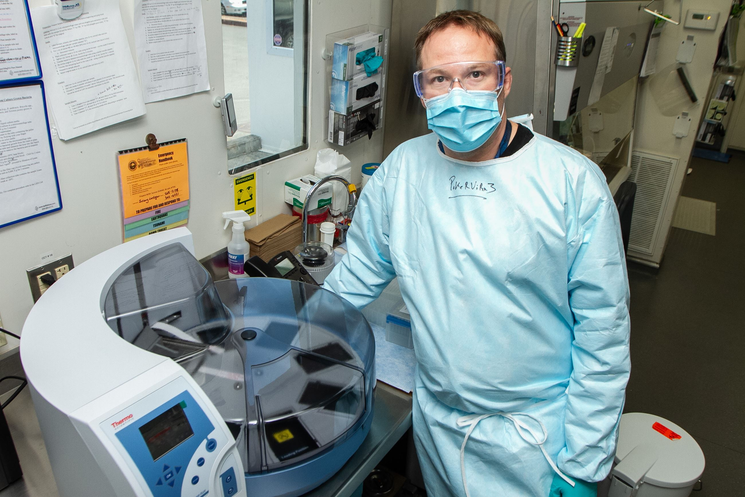 Public Health Laboratory Manager Jeremy Corrigan with the delivered Kingfisher Flex RNA extractor